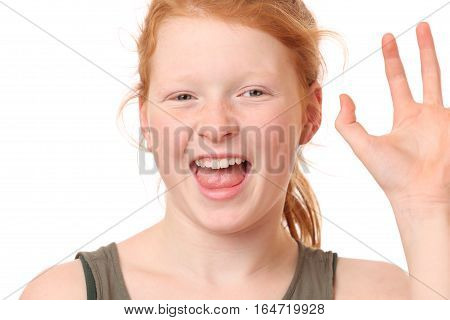 Portrait of a funny teenage girl on white background