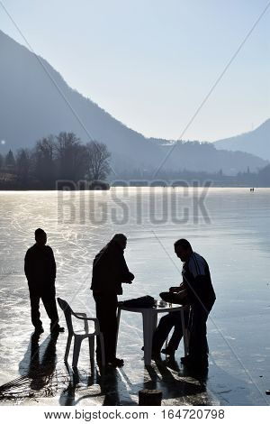 Sunday, January 8, 2017-Lake Endine-Bergamo-Lombardia-Italy-A group of unidentified people having fun on the ice of Lake Endine, a rare phenomenon of glaciation just 373 m. above sea level.