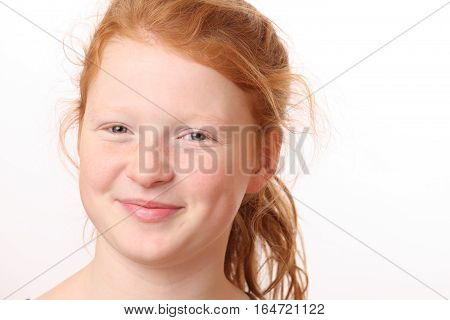 Portrait of a happy teenage girl with red hair on white background