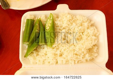 asian fast food take away rice and beans in container