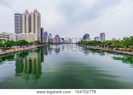 KAOHSIUNG TAIWAN - NOVEMBER 26: This is a view of the love river with Kaohsiung financial district in the distance on November 26 2016 in Kaohsiung
