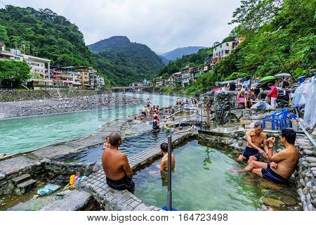 TAIPEI TAIWAN - NOVEMBER 29: Taiwanese people bathing in public hot springs baths in Wulai village on November 29 2016 in Taipei