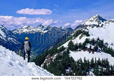 Man standing on mountain top with snow. Mount Baker National Forest. Bellingham. Seattle. Washington. United States.