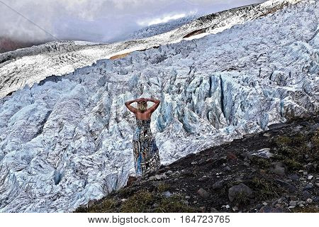 Woman by glacier. Coleman Glacier. Heliotrope Ridge. Mount Baker National Forest. Washington. United States.