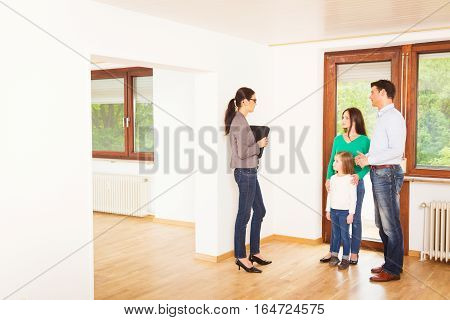 realtor showing a family of three an apartment
