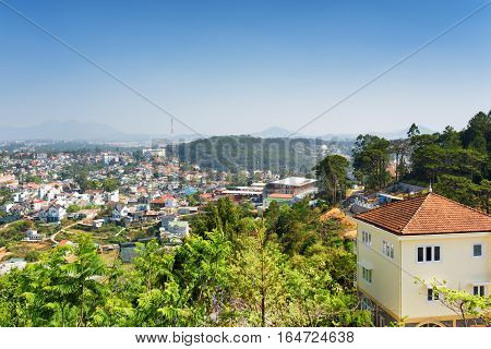 House With Tile Roof And A Beautiful View Of Da Lat City (dalat) On The Blue Sky Background In Vietn