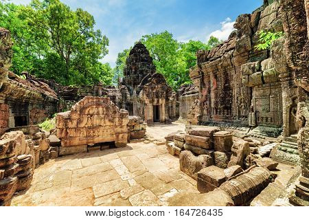 Mossy Buildings With Carving Of Ancient Ta Som Temple In Angkor