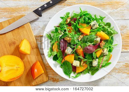 Salad With Persimmon Slices, Mix Of Lettuce Leaves, Blue Cheese