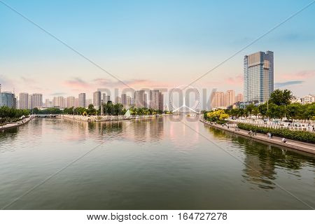 beautiful haihe river and ferris wheel at dusk in tianjin China
