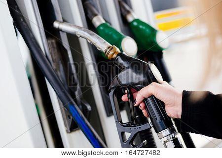 Woman Holding Diesel Fuel Nozzle