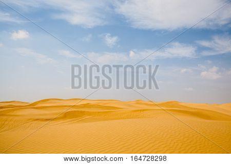 desert landscape with blue sky dunes background