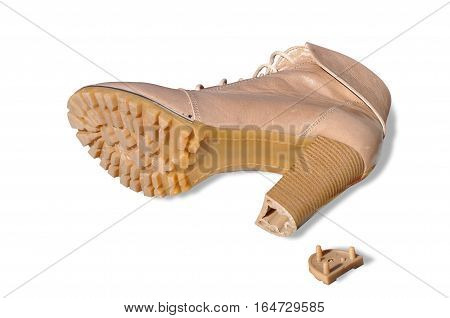 one shoe with broken by heel on white background