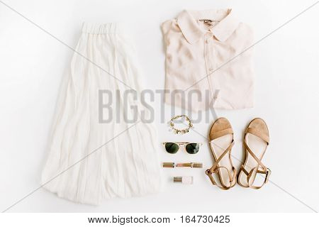 Stylish trendy feminine clothes and accessories. Flat lay top view