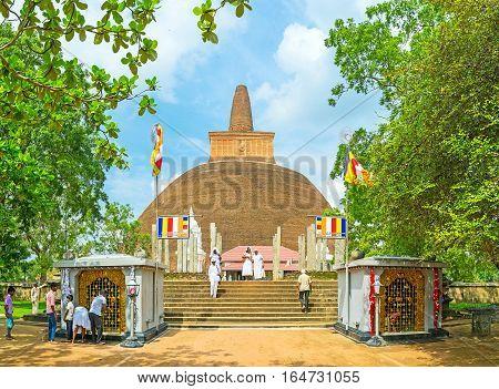 ANURADHAPURA SRI LANKA - NOVEMBER 26 2016: The view on Abhayagiri Stupa through the grenery of Mahamevnawa Park on November 26 in Anuradhapura.