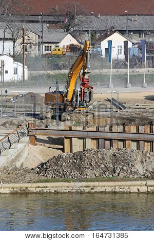 Excavator digging and moving earth at construction site in Belgrade,Serbia