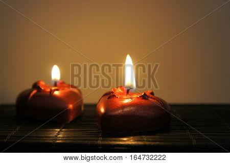 Two candles in the shape of hearts