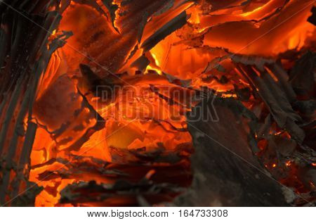 smoldering fire embers with the ashes background