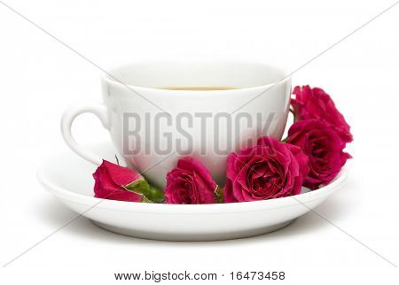 white cup of coffee with red roses