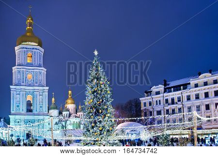 Beatiful view of Christmas on Sophia Square in Kyiv Ukraine. Main Kyiv's New Year tree and Saint Sophia Cathedral on the background