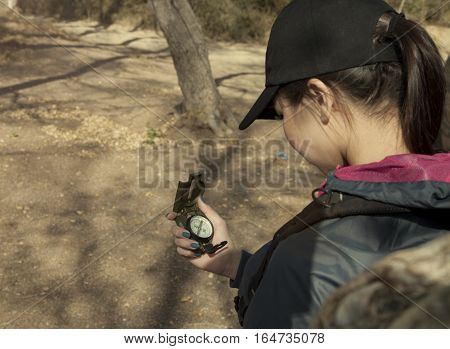 Compass in the asian woman hand tourism and travel photo