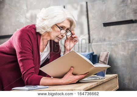 Senior Woman Reading Book