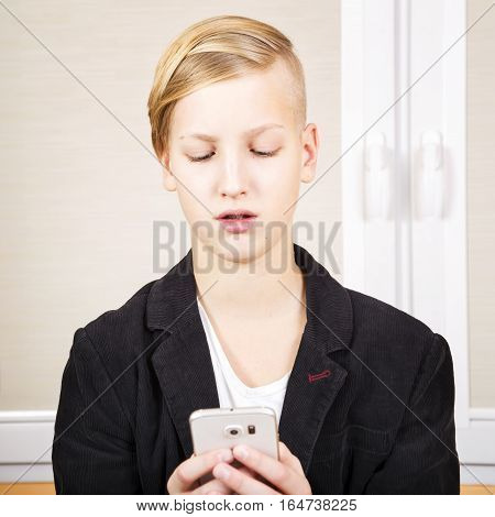Teenager with phone in hands. Internet dependence computer games