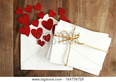 Blank Envelopes For Valentine's Love Letters, With Heart Shapes On Wood Background