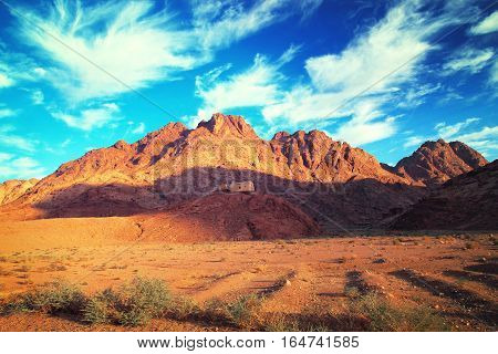 House On Hill In Desert Next To Mountain. Beautiful Landscape.