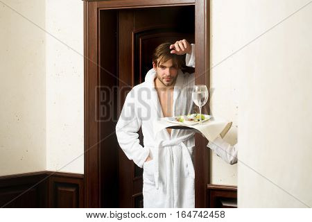 Bearded Man And Tray In Hotel