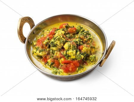 Vegan and vegetarian dish, spicy curry from tofu in copper bowl. Indian cuisine with herbs, healthy meal closeup isolated on white background. Eastern local cuisine restaurant food.