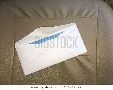Opened important letter on leather chair background