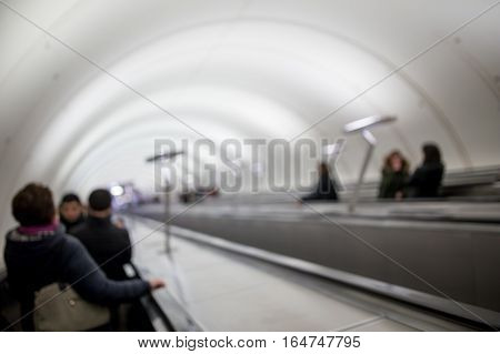 Blurred picture of escalator subway with people