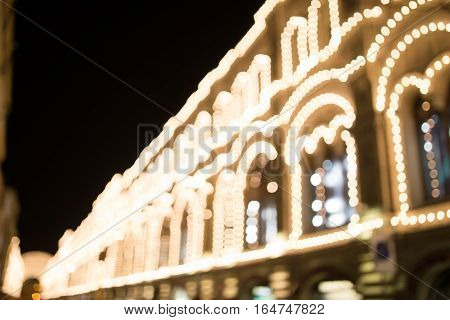 Naturally blurred photo of building with garlands at night