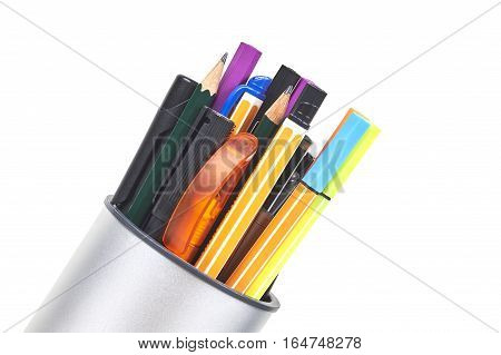 Different Pens Markers In A Holder Over White Background