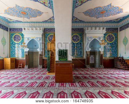 TBILISI, GEORGIA - August 06, 2015: The interior of Jumah (Friday) Mosque, decorated with arabic inscriptions from Quran and floral ornaments in blue gamma