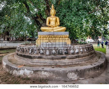 Luang Prabang, Laos - December 3, 2015:  Golden Buddha statue in Laos