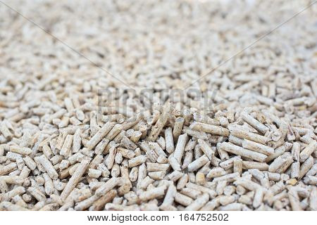 Heap of fir pellets- biomass stock photo