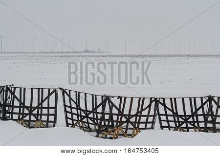 Bucharest Romania December 26 2012: Snow fencer are seen on a snowy field outskirts Bucharest.