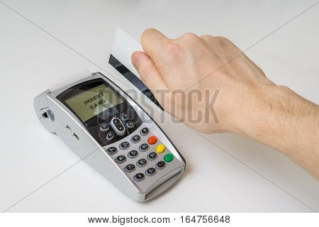 Customer Is Swiping Magnetic Credit Card In Payment Terminal.