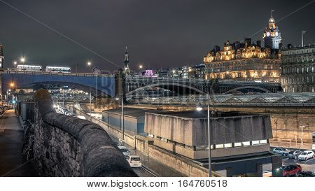 Edinburgh, UK - November 14, 2016: Edinburgh skyline as seen from old town near the train station and North bridge