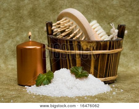 washtub with bath salt and candle