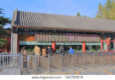 BEIJING CHINA - OCTOBER 28, 2016: Unidentified people buy admission for Lama Temple. Lama Temple originally served as an official residence for court eunuchs built in 1697