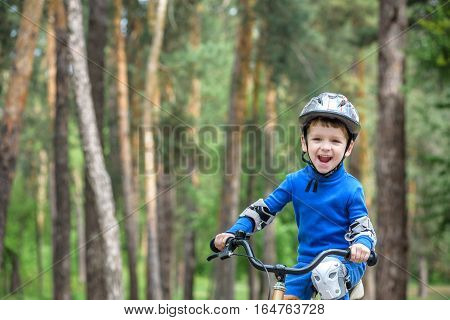Little Kid Boy Of 3 Years And His Father In Autumn Forest With A Bicycle. Dad Teaching Son. Man Happ
