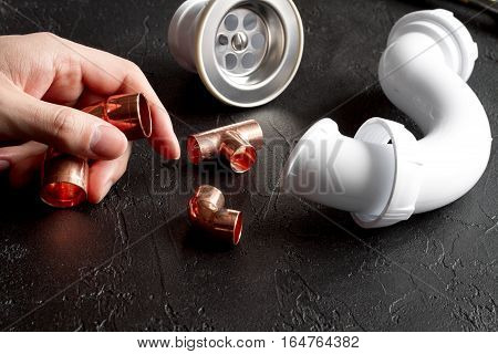 concept plumbing tools on dark background close up
