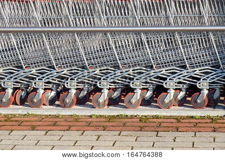 row of shopping trolleys or carts in supermarket .