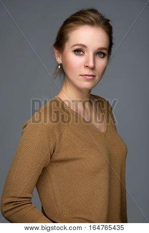 Beautiful Girl Isolated Over Grey Background