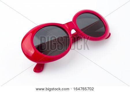 cute red round sunglasses on white background