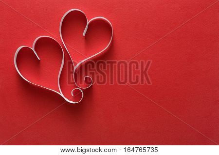 Valentine background with handmade paper heart shapes decoration on red. Happy lovers day card mockup, copy space