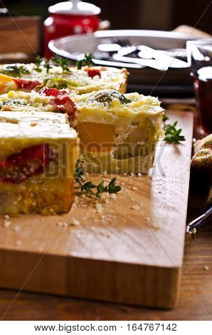 Casserole with vegetables and pasta on the wooden background. Selective focus.