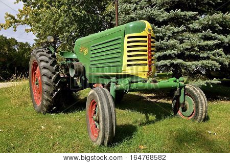 SHELDON, NORTH DAKOTA, September 29, 2016:  The old green restored tractor  of the Oliver Farm Equipment Company which was purchased by White Motor Corporation in 1960.